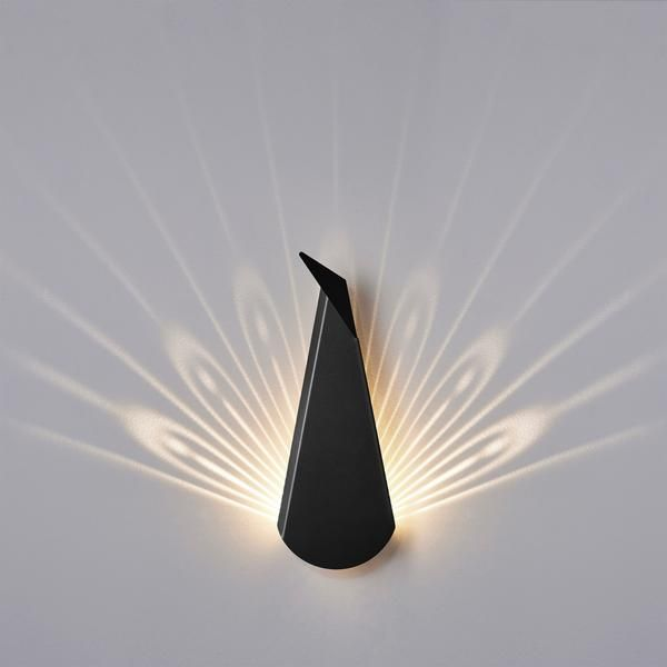 The Popup Lighting Black peacock is a decorative lamp, painted folded Aluminium and steel. When lights are on it becomes 40x40cm of light and brilliancy.