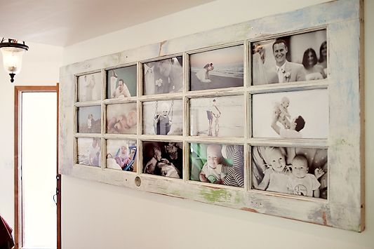 an old door turned into a photo board  LOVE THIS!