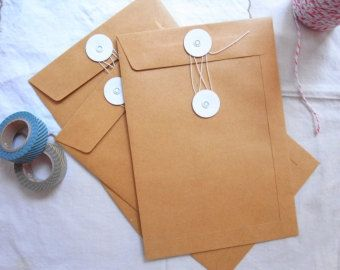 C6 String and button envelopes in brown kraft by BellaStationery