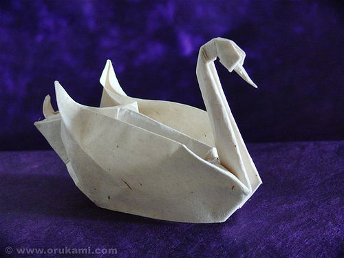How to make an origami swan - http://www.ikuzoorigami.com/how-to-make-an-origami-swan/