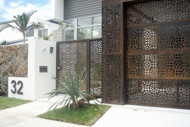 Entry gate, garage walls and panel lift door panels – rust finish. By Screen Art