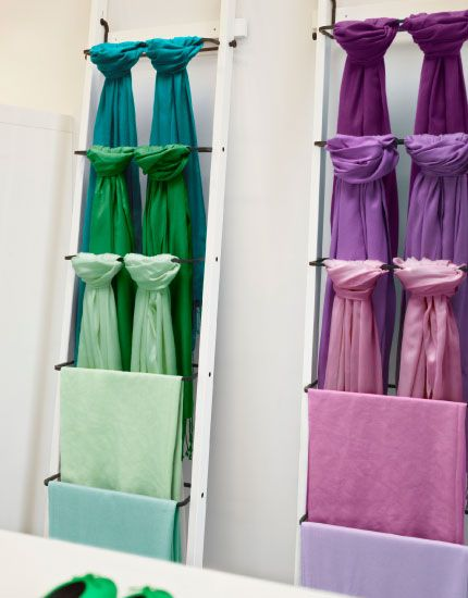 Scarves in different colors displayed on HJÄLMAREN white towel holder
