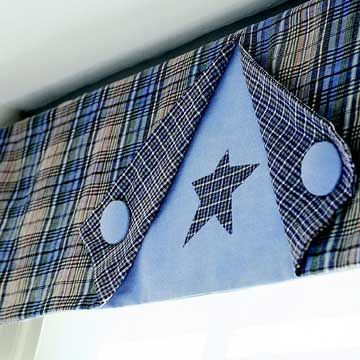 Button Valance: Sew two sections of lined fabric and set them over a third panel of plain blue. Fold the two corners back to reveal a decorative star; keep them tacked down with a covered button. This is a simple but effective look for a boy's room or family room.