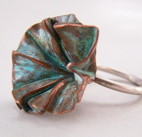 Lots of beautiful copper jewelry in this photogroup, e.g. this foldformed blossom