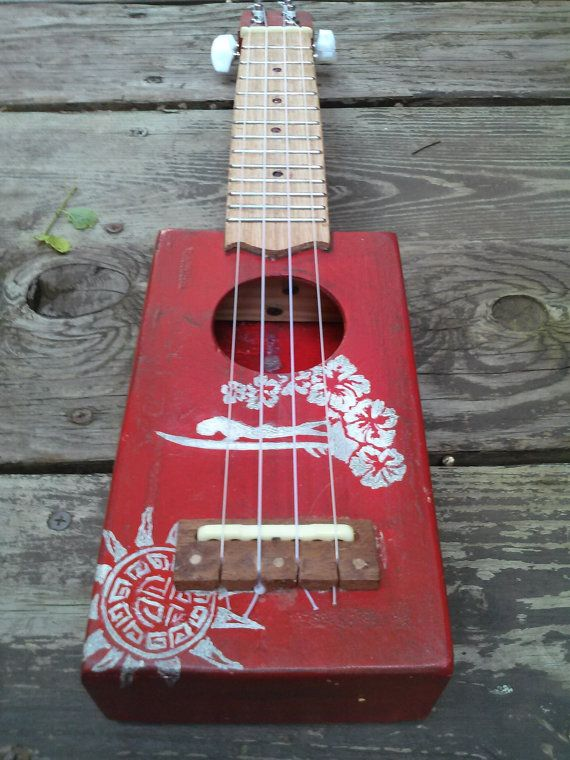 soprano ukulele made entirely from salvage materials (except for the strings and tuning machines). I cut a slice of cedar to use for the sound board
