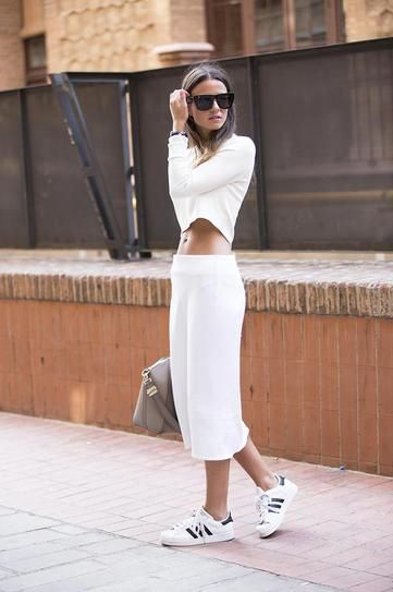 Skirts & Sneakers Trend: All white matching midi skirt and long sleeve crop top, worn with black and white Adidas.