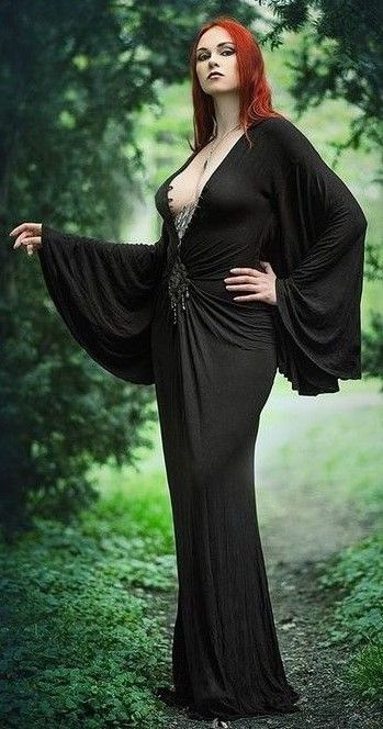 Revena gothic pinup portrait standing pose in long black cape like dress