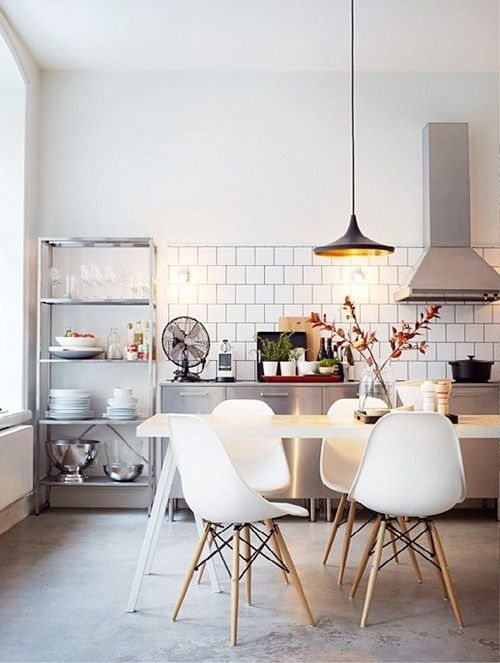 Kitchen with subway tile and pendant lighting