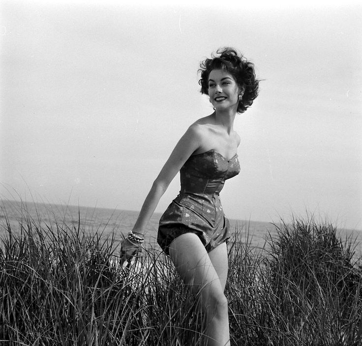 """Nancy Berg in """"Hourglass Maillot"""" that squeezes the waist and accents the hips by Rose Marie Reid of acetate satin, photo by Nina Leen, July 1952"""