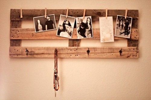 Super easy to DIY- pellet wood, clothespins and string, and some coat hooks