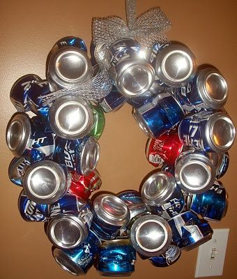 Beer Can Wreath! I made one as a gag gift for my sister, using a coat hanger & crushed cans! Cost $0.00...I actually think we could make money recycling this! Haha