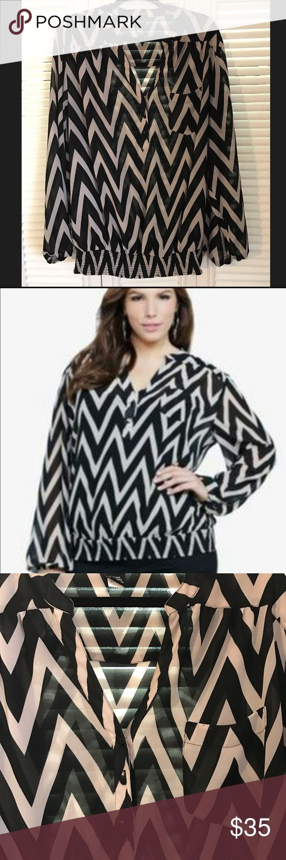 Chevron top! Must have! Make waves with a unique print! This taupe & black chevron print to be specific (it's redefining eye-catching). Splashed onto breezy (and sheer) chiffon, the dolman top gets a bold boost from the elastic waist band! torrid Tops Blouses