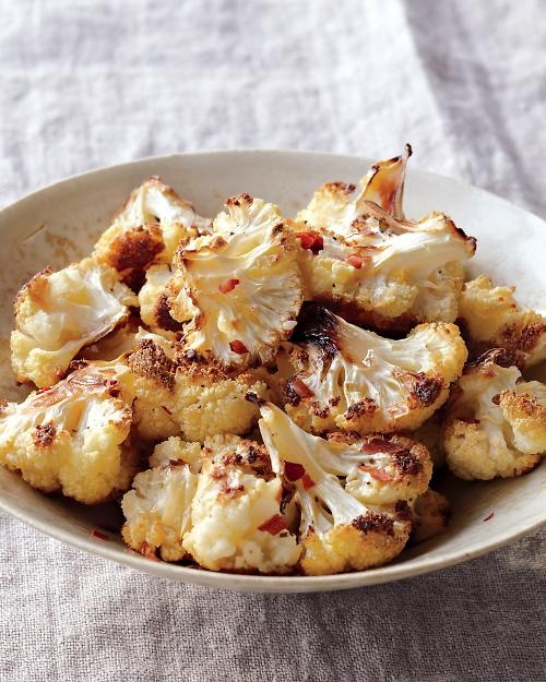 Sensible and satisfying snack or side dish - Crispy Roasted Cauliflower. 1/2 head of cauliflower, olive oil, salt, and red chile flakes...roast for 20 minutes at 425.