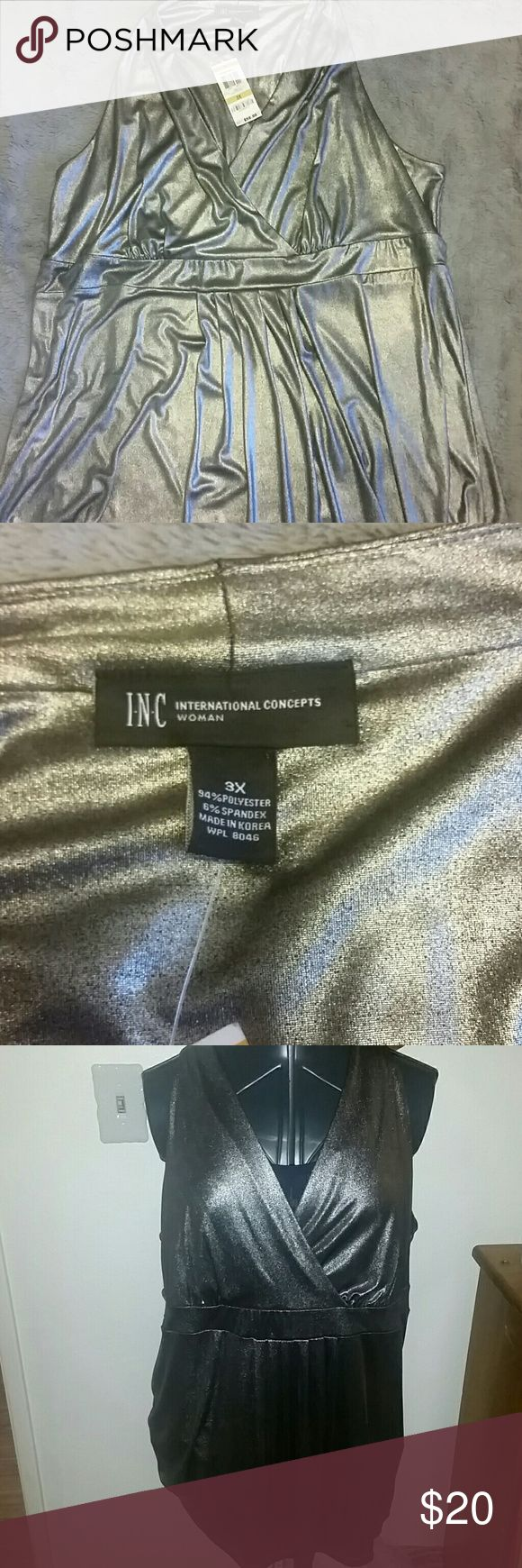 INC silver short sleeve top size 3xl This is a cute INC top never worn.  Empire waist with pleated front.  Sliver metalic in color and size 3x. INC International Concepts Tops Tank Tops