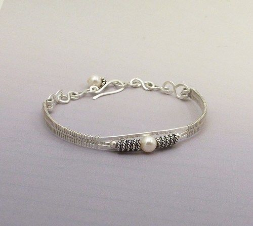 Timeless pearls accent this hand crafted sterling silver woven wire bracelet. One of the birthstones for June is pearl.  Lovely gift for graduation, wedding or any other occasion.    The wire base has