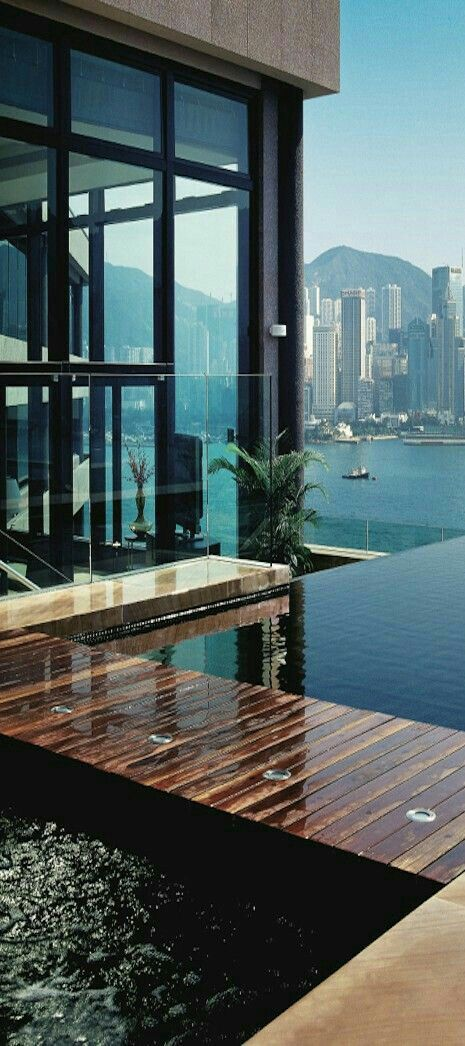 I'm guessing this is Hong Kong. The view is spectacular! And this house looks stunning. Perhaps due to the location? Love the infinity pool and wooden deck. | SV