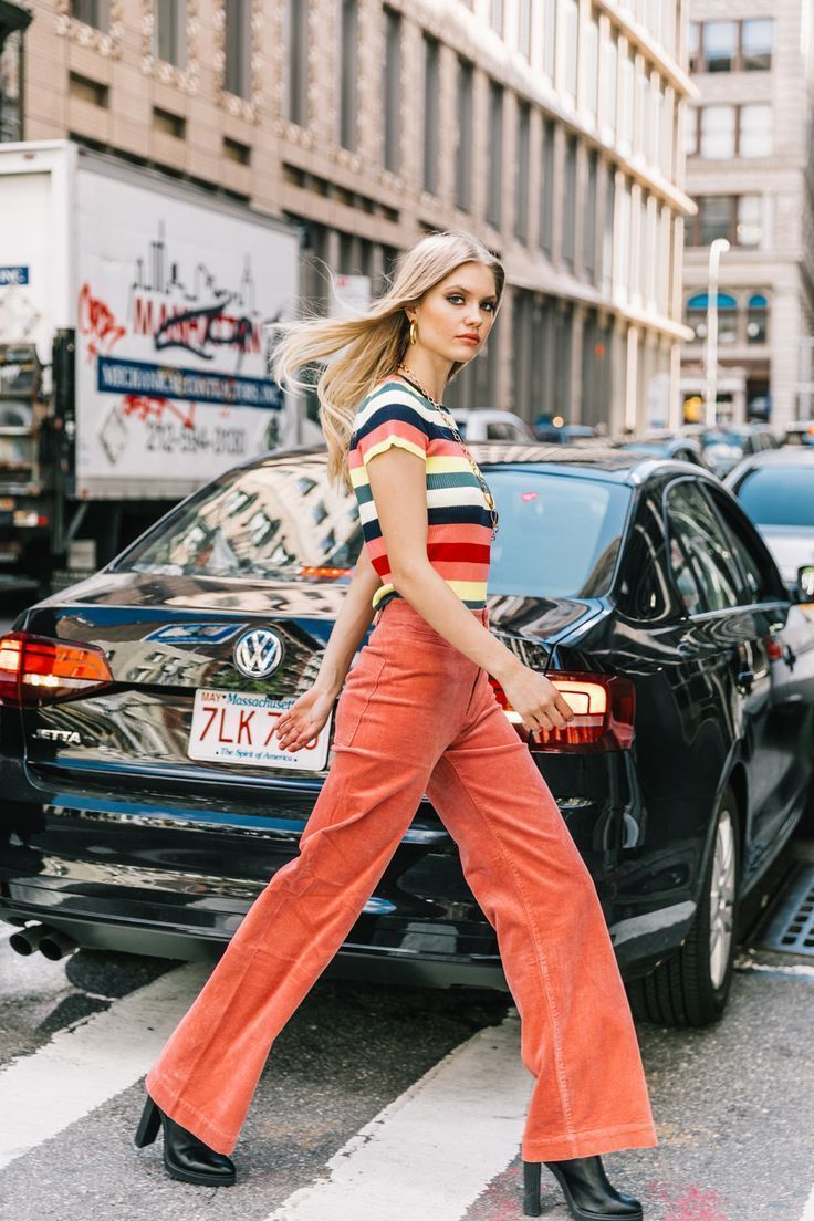 Sassy striped top and orange pants Street Style NYFW Spring