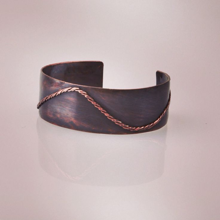Curve. This vintage style copper bracelet is hammered into lightly domed style and colour with patina