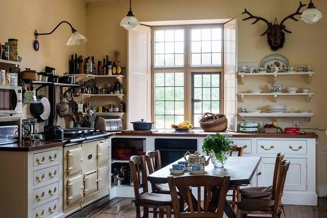 Country House Kitchen with Aga and built-in cupboards| Kitchen Design Ideas. A newbuild Jacobean-style manor near the site of a demolished Sussex country house - real homes by House & Garden