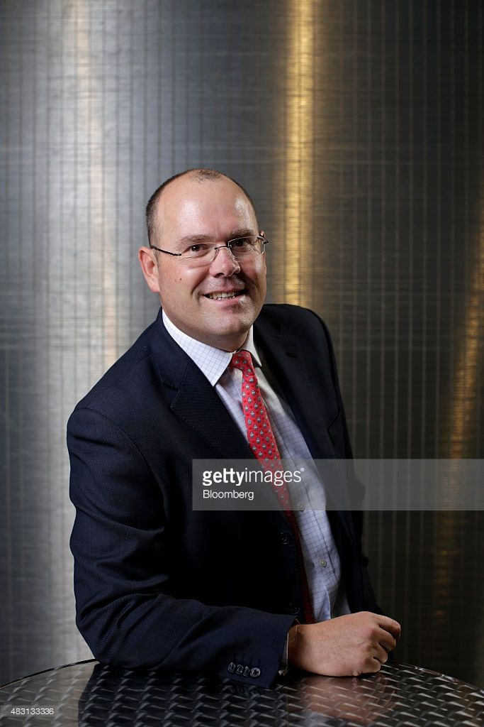 Graham Shuttleworth, chief financial officer of Randgold Resources Ltd., poses for a photograph before a news conference announcing the company's half-year results at the London Stock Exchange in London, U.K., on Thursday, Aug. 6, 2015. Randgold, the best-performing gold mining stock in the past decade, is getting ready for another plunge in prices. Photographer: Matthew Lloyd/Bloomberg via Getty Images
