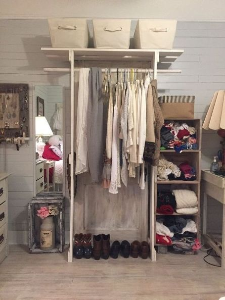 This is a genius way to add closet space, keep an open look and feel to a room and recyle an old door.  DIY free-standing closet.