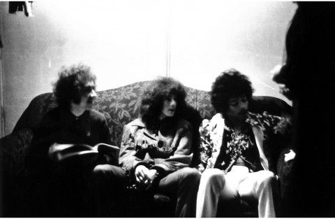 Members of the Jimi Hendrix Experience, from left, Mitch Mitchell, Noel Redding and Hendrix, sit on a couch during their gig at the Ambassador in Washington, D.C. August 1967. (Shep Tullier)
