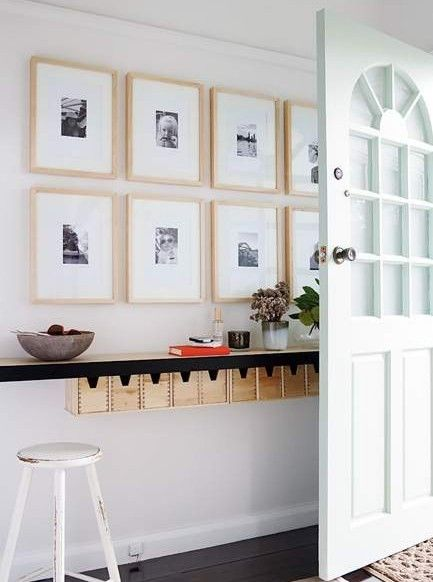 good and budget-friendly idea for an entrance. Ikea ribba frame with small b&w squared pictures look goood.