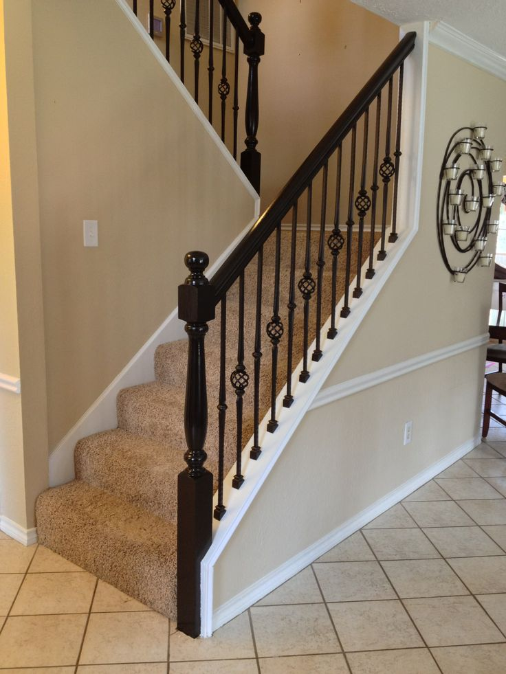 For the Fabjanic remodel, we installed our PC12/1 powder coated wrought iron single basket hammered baluster, along with our PC16/1 powder coated wrought iron single collar hammered baluster, both in our Old world Copper color. We also refinished the rails and newel posts from the drab old oak color to a deep ebony color to match the front door and a furniture piece in the home - Bringing this stairway from the 80's to 21st century styling.