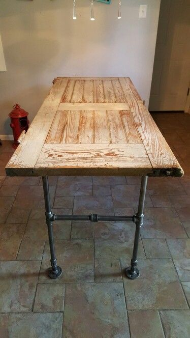 Old barn door turned into a table with pipes!                                                                                                                                                                                 More