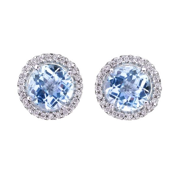 A very elegant pair of pale blue topaz and diamond cluster earrings. Round cut sky blue topaz, of 2.66cts, surrounded by brilliant cut diamonds, mounted in a fine 18ct white gold setting.