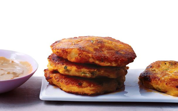 Llapingachos! I ate these when I lived in Argentina - potato cakes with creamy centers. Amazing!