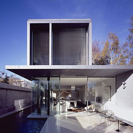 Called Ross Street, the front facade has no windows at all to shut out noise from the street, while the ground floor at the back of the house is glazed floor to ceiling. #architecture