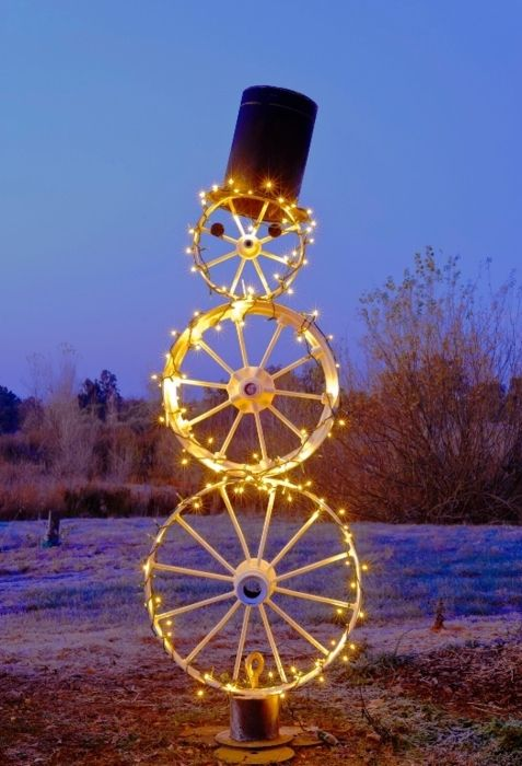 Lighted Wheel Snowman - Nice! This way you can skip the freezing step of building one out of snow! Click here for some durable lights for it!