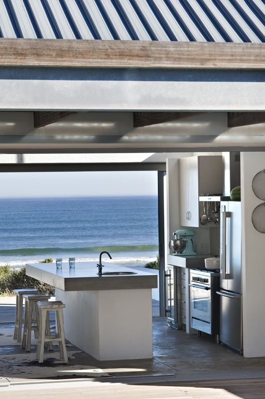coastal kitchen with incredible view of the beach ocean.