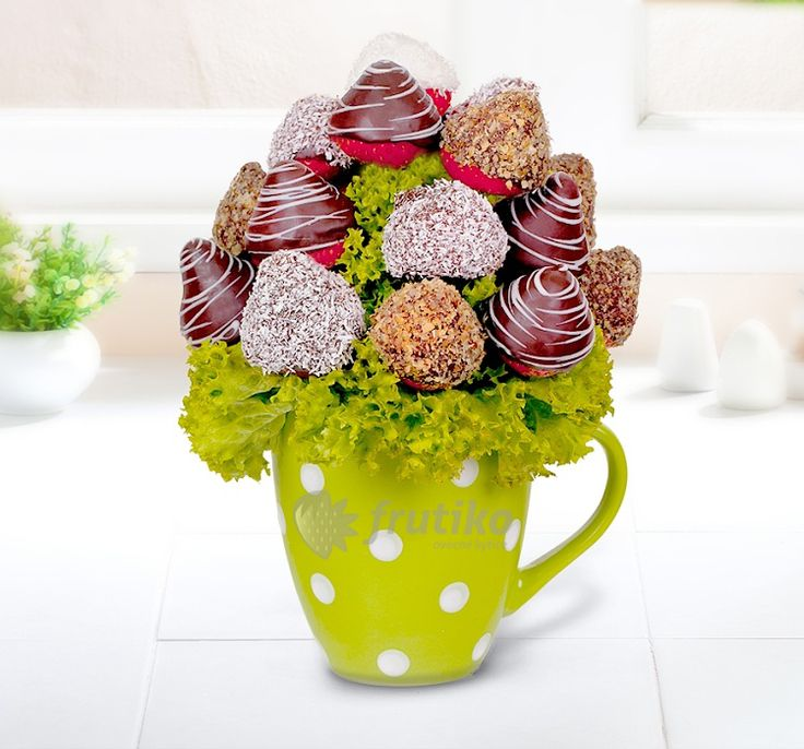 Best wishes is fruit flower from strawberries with chocolate and nuts.