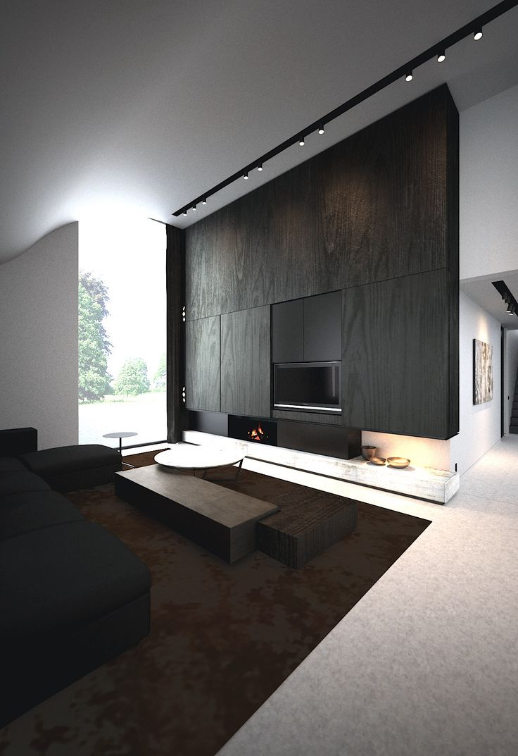 contrasting living room. Great emphasis on the fireplace. Wonderful lighting. Shapes make a bold statement. Curved walls and monolithic fireplace wall.
