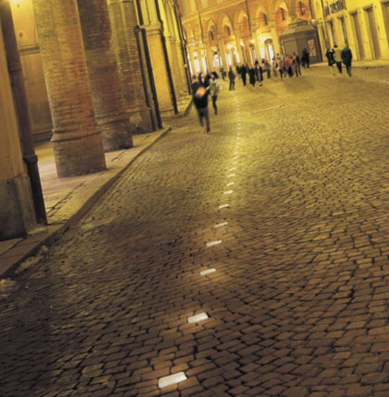 Our Italian inspired line of LED Landscape lighting offers a unique alternative to traditional walkway lighting.  Our recessed lighting fixtures, like those shown below, can withstand light weight car traffic and the normal wear and tear from public walkways.