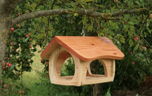 Wooden bird feeder                                                       …