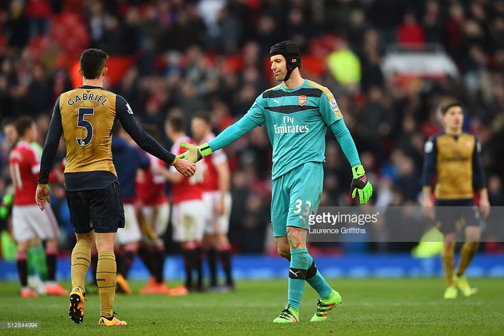 Petr Cech of Arsenal shakes hands with Gabriel Paulista of Arsenal after the Barclays Premier League match between Manchester United and Arsenal at Old Trafford on February 28, 2016 in Manchester, England.