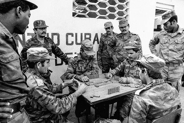 Cuban soldiers in Angola playing dominoes during some down-time. Date unknown.