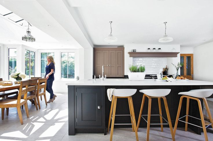 A 1950s four-bedroom equestrian property in Surrey. The old lean-to was replaced with a large hardwood orangery. The brief was to design a spacious kitchen with large communal island and a separate boot room.
