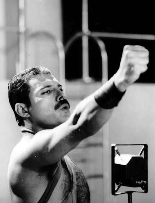 Freddie Mercury on the set of 'Radio Ga Ga' video, filmed in November, 1983. °