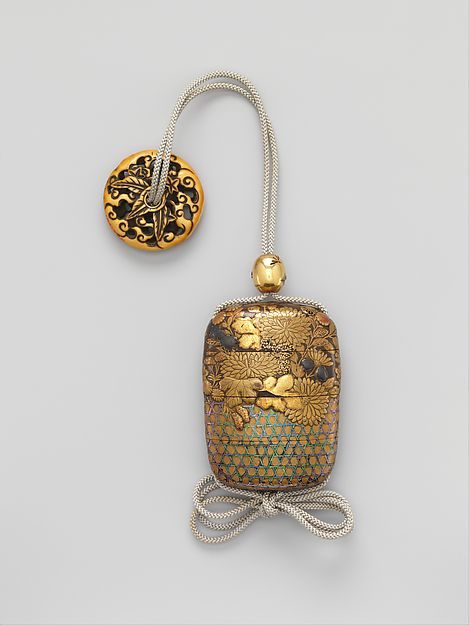 Case (Inrō) with Chrysanthemum Decoration Case (Inrō) with Chrysanthemum Decoration Period: Edo period (1615–1868) Date: 18th–19th century Culture: Japan Medium: Gold and silver maki-e with inlay of mother-of-pearl on lacquered ground Dimensions: 2 15/16 x 2 1/8 x 1 in. (7.4 x 5.4 x 2.5 cm) Classification: Inrō Credit Line: H. O. Havemeyer Collection, Bequest of Mrs. H. O. Havemeyer, 1929 Accession Number: 29.100.876