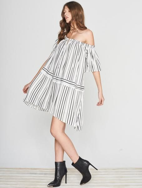 ISLA RUNAWAY DRESS Show your stripes. You're confident and carefree, that's why the Runaway Dress has a cool off the shoulder look, a billowing silhouette, with a high - low hem, front tie feature, and cropped bell sleeves - she's easy and breezy just like you.  Available www.islalabel.com