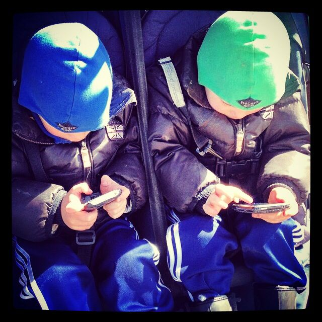 Twin phone nerds - just like their Daddy
