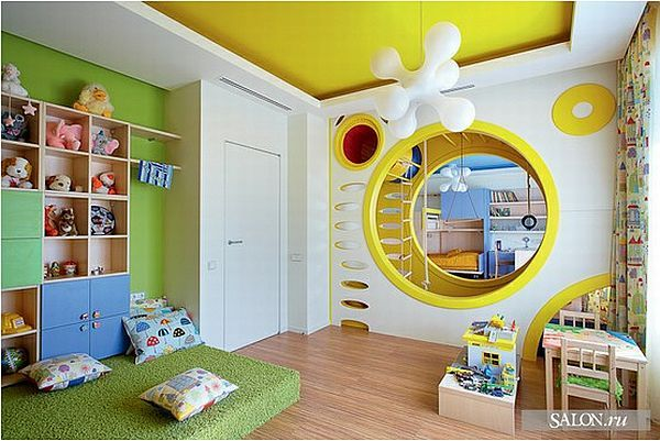 The masterpiece of this top is a great playroom with a false wall in the middle. This wall is used to separate the room in two, for two kids and also to make your own indoor slide and climbing spot, with interior ladders and round holes in the walls, with funny modern lamps hanging from the ceiling. It shows tons of imagination and an eye for interior design.