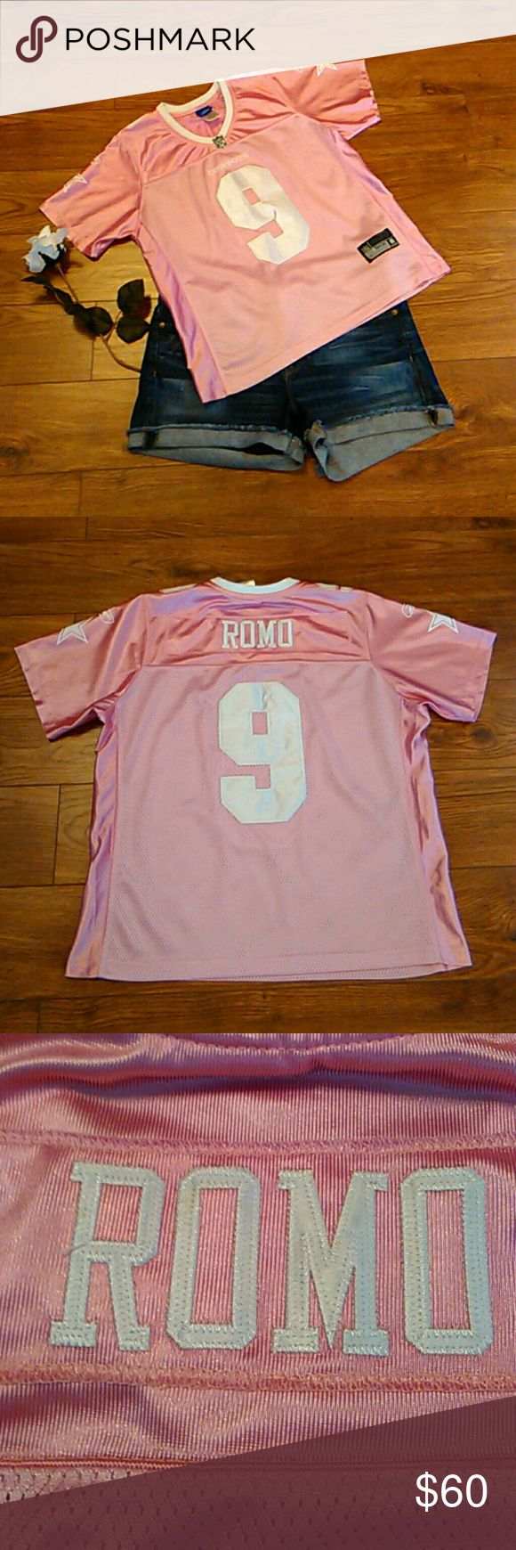 "Dallas Cowboys Romo Pink Jersey Top Size L Dallas Cowboys Tony Romo 9 Pink RBK Jersey Top Size L Girls  Room & 9 Patches are Sewed on Dallas Cowboys Star, Reebok Symbol & 9 decals on arms and shoulders. NFL Reebok   88% Nylon 12% Polyester  Aprox Measurements Taken Flat  Shoulders: 14.5"" Bust: 20.5""(41) Length: 23""  In Pre-owned Condition With No Stains Or Holes  Smoke and Pet Free Home  Please Check Out My Other Items  #125 Reebok Shirts & Tops Tees - Short Sleeve"