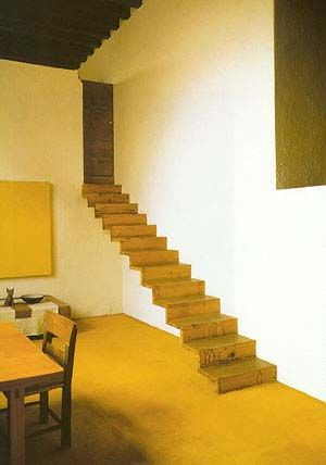 barragan - casa barragan  cantilever stairs  simple handmade furniture designed by barragan   living room with wall size window simple plank floor