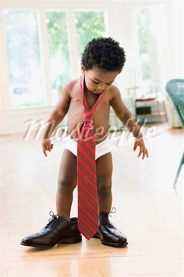 African Toddler Wearing Father S Shoes And Tie Stock
