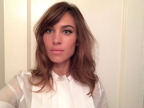 Alexa Chung hair and makeup. Would someone also please tell her that when your skin goes darker in the summer, so should your lipstick!!